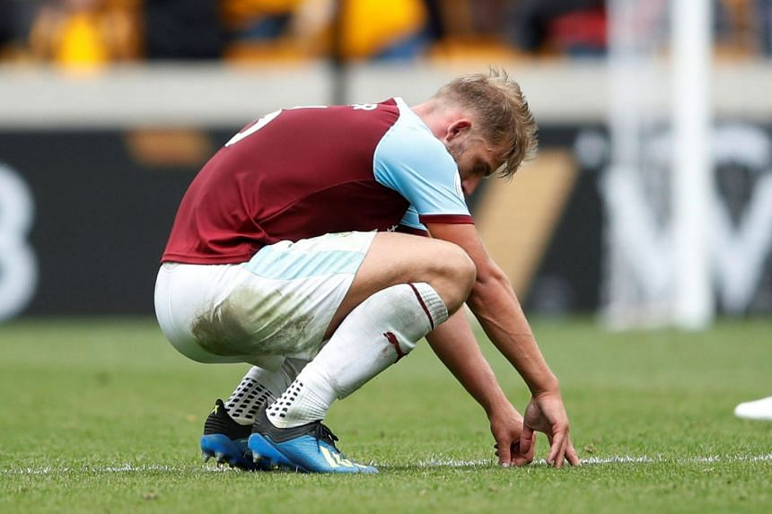 Burnley's Charlie Taylor looking dejected at the end of the English Premier League match with Wolverhampton Wanderers.