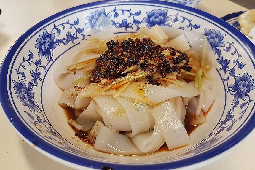 The Shaanxi cold noodles pack some heat, but the coolness of the noodles also makes this a refreshing option in hot weather.