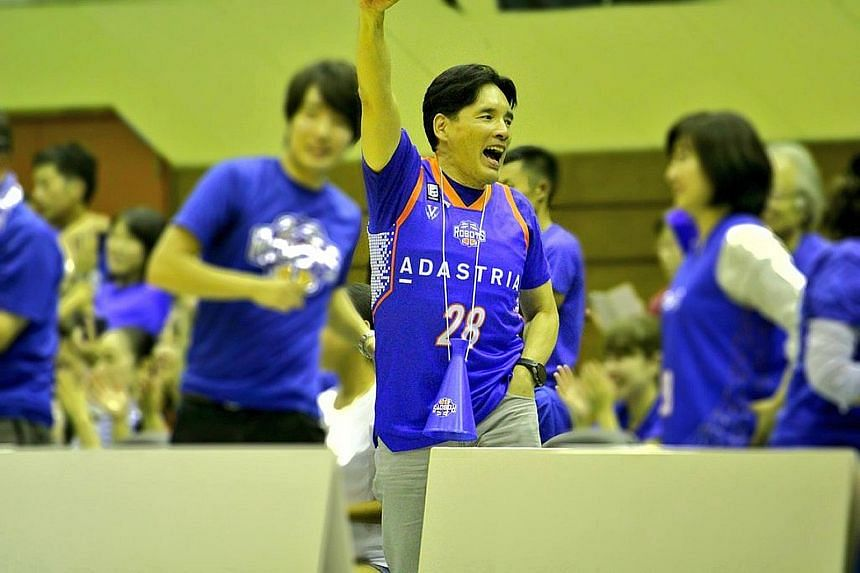 Mr Hori cheering on his professional basketball team, Ibaraki Robots, with his wife and one of his five sons. Globis Management School founder Yoshito Hori believes in the power of education and in giving back to the community. Among his many initiat
