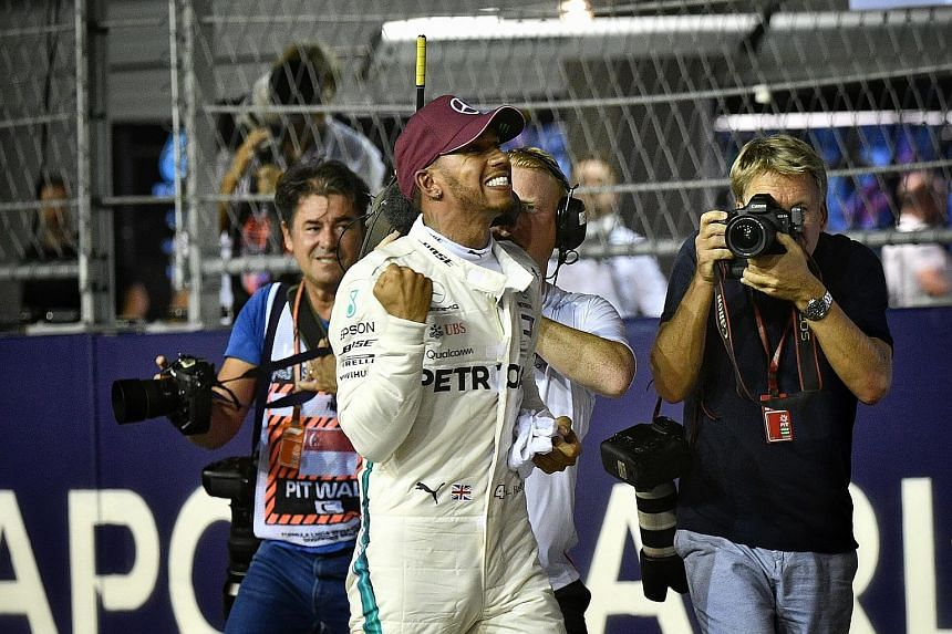 """Above: Lewis Hamilton celebrating his hard-won pole in what he called """"a hardcore qualifying session"""". Left: Fans at the Liam Gallagher concert. The singer thrilled the audience with his hour-long set at the Padang stage."""