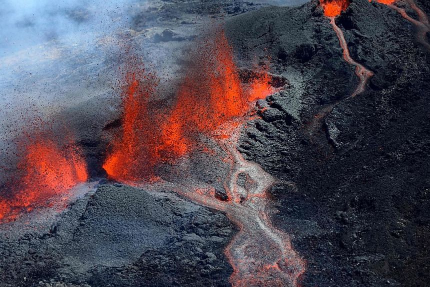 Lava flowing down the south face of the Piton de la Fournaise, or the Peak of the Furnace, yesterday on Reunion Island, a French region in the Indian Ocean. Peaking at 2,632m, Piton de la Fournaise, a tourist hot spot which has erupted several times