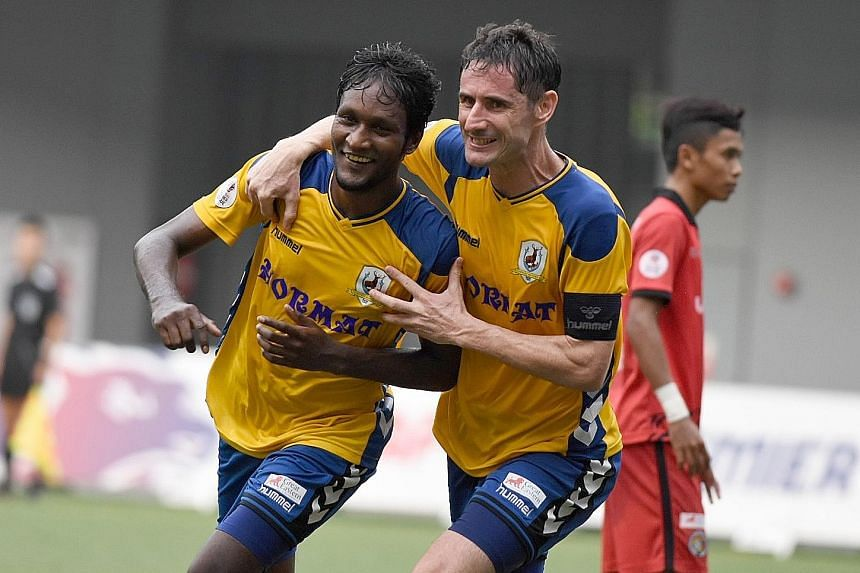 Madhu Mohana (left) and Daniel Bennett are overjoyed after the former's headed goal for Tampines Rovers in yesterday's SPL match against Balestier Khalsa at Our Tampines Hub.