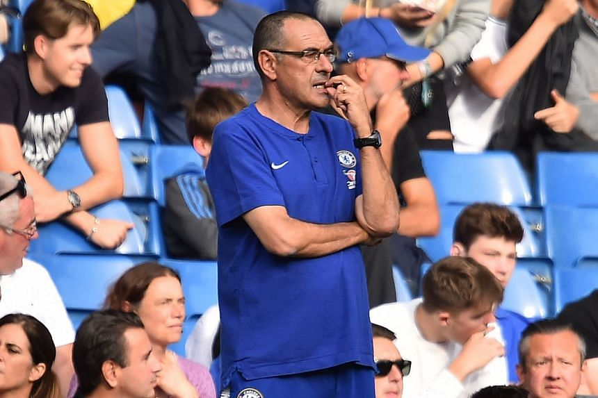 Sarri watching during the match against Cardiff City.