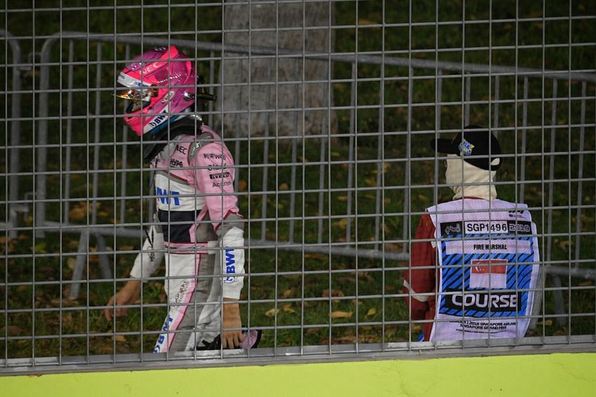 Force India's Esteban Ocon walks out of the track after crashing out of the 2018 Singapore Airlines Singapore Grand Prix on Sept 16, 2018.