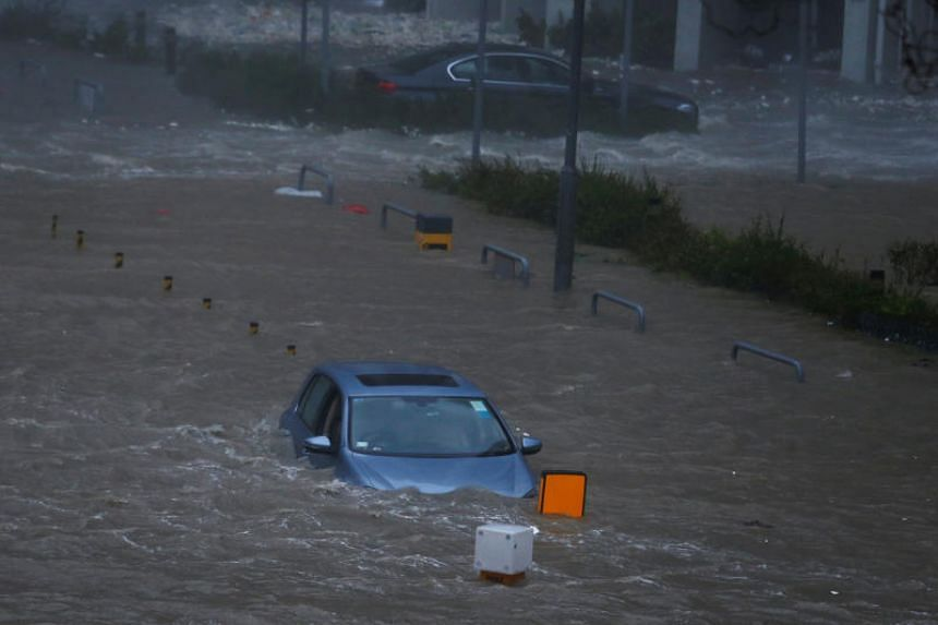 Cars are stranded in seawater as high waves hit the shore at Heng Fa Chuen, a residental district near the waterfront, during Typhoon Mangkhut in Hong Kong on Sept 16, 2018.