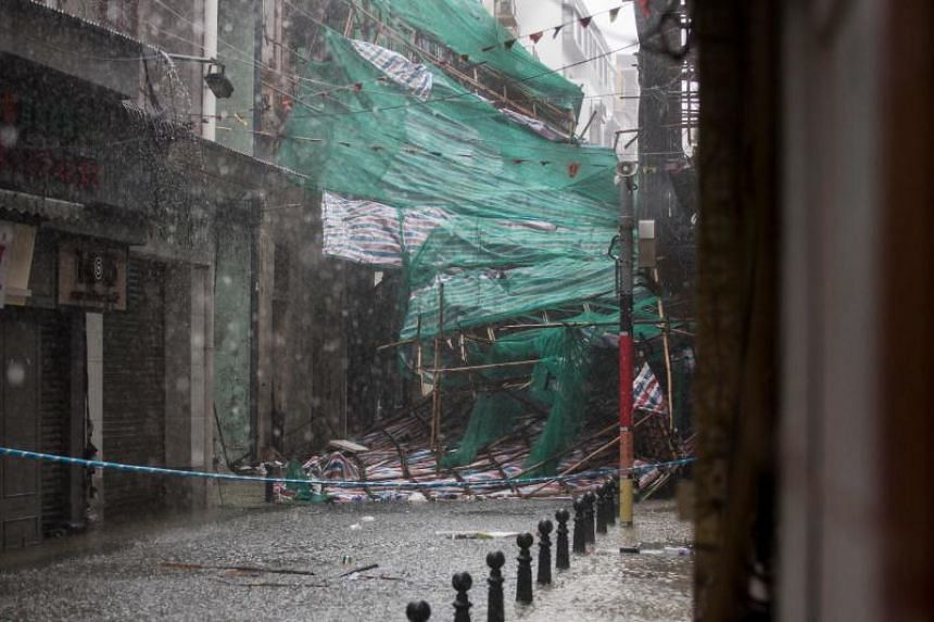 Bamboo scaffolding is brought down during Typhoon Mangkhut in Macau on Sept 16, 2018.