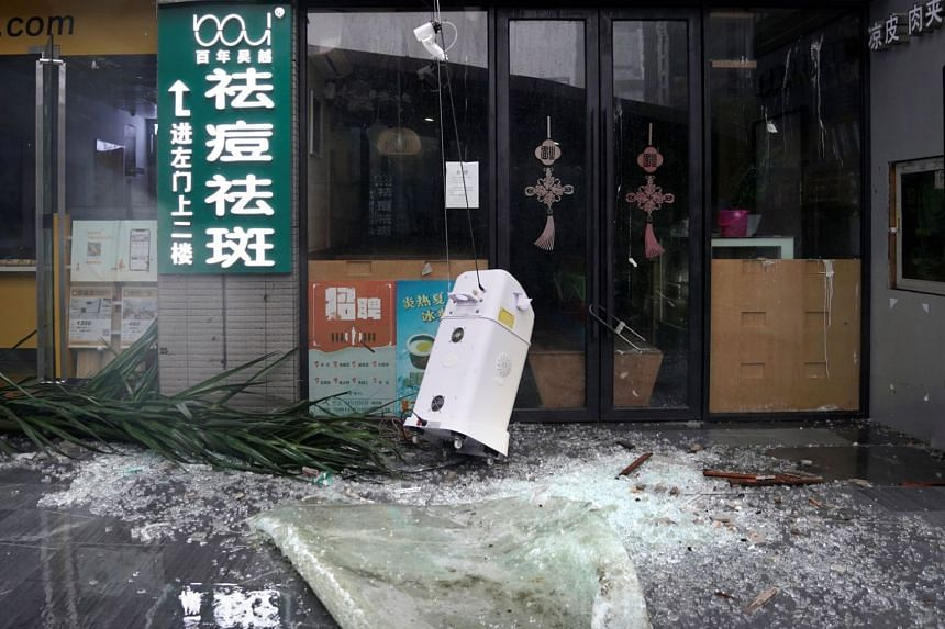 Broken glass is seen in a restaurant as Typhoon Mangkhut makes landfall in China's Guangdong province, in Shenzhen, on Sept 16, 2018.
