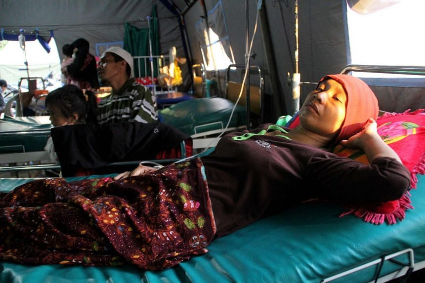 An Indonesian woman suffering from malaria being treated at a village clinic in Gunung Sari, West Lombok, on Sept 11, 2018.
