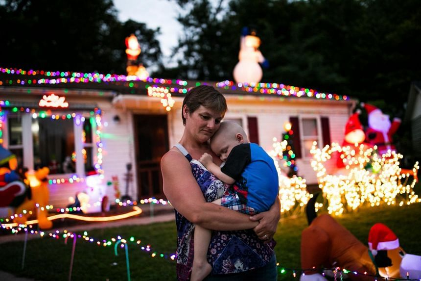 Shilo Allen holding her son Brody, 2, on Friday outside their home in the suburbs of Cincinnati.