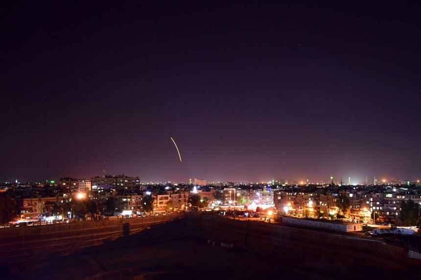A Sana photo reportedly shows Syrian air defence batteries responding to Israeli missiles.