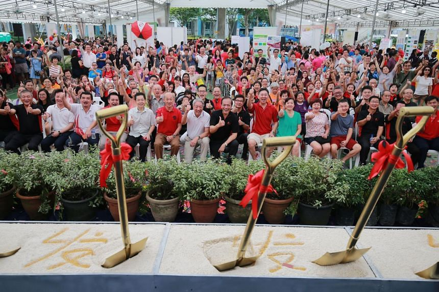 Deputy Prime Minister Teo Chee Hean (centre, in white) and Punggol East MP Charles Chong (centre, in black) posing for a group photo with residents and others during the ground-breaking ceremony for the new Rivervale Community Club on Sept 16, 2018.