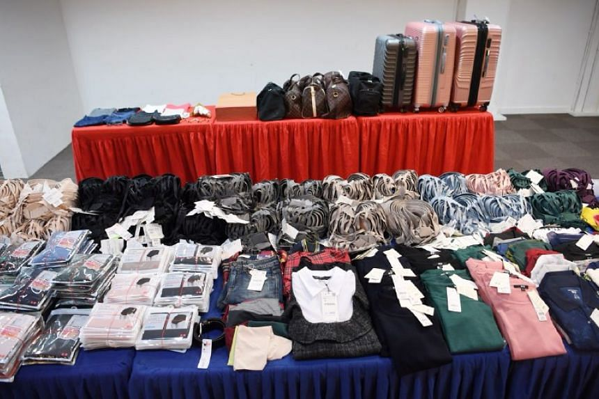 The two men and two women are accused of stealing about $26,000 worth of women's clothing, including undergarments.