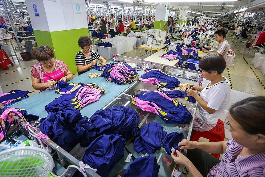 Workers at a swimwear factory in Jinjiang in China's eastern Fujian province. Wall Street pared gains just before closing last Friday, following a Bloomberg report that US President Donald Trump had instructed aides to go ahead with the next round of tari