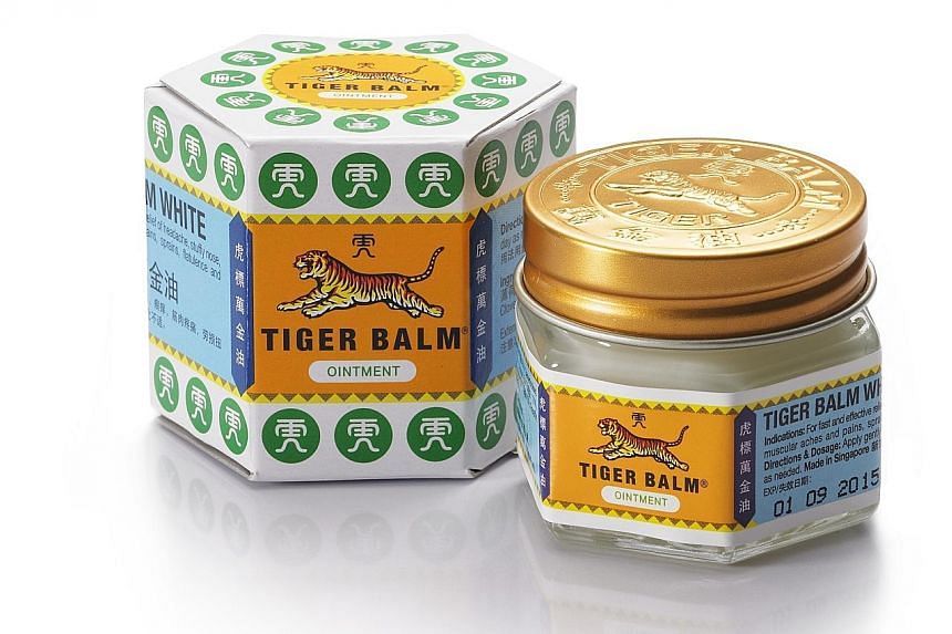 """Mr Aw Boon Haw (top), whose name means """"gentle tiger"""", was one of the two sons of herbalist Aw Chu Kin. The younger Mr Aw named the special ointment Tiger Balm (above)."""