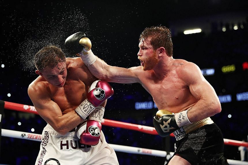 Saul Alvarez lands a right hook on Gennady Golovkin during their WBC/WBA middleweight title fight at the T-Mobile Arena in Las Vegas on Saturday. Alvarez won by a majority decision after 12 rounds.