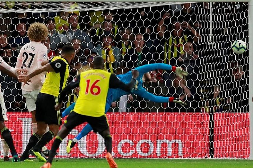 Top: Chris Smalling volleying in United's second goal in the Premier League game against the previously unbeaten Watford at Vicarage Road on Saturday. Above: Goalkeeper David de Gea saving Christian Kabasele's (not in picture) header in stoppage time