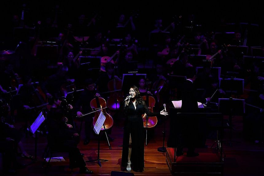 Vocalist Chriz Tong singing at The Story Of Singapore concert commemorating the 95th anniversary of Chinese newspapers in Singapore.