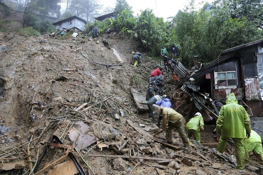 Rescuers and volunteers search for three missing persons after Typhoon Mangkhut triggered a landslide in Balacbac, Baguio City, north of Manila. Scores of people have died but the storm's initial casualty toll was far lower than officials had feared.