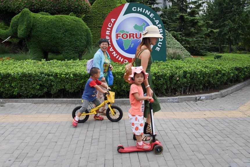 Women and children seen in Beijing on Sept 3, 2018. China is encouraging women to have more children to avert the kind of demographic crisis affecting Japan.