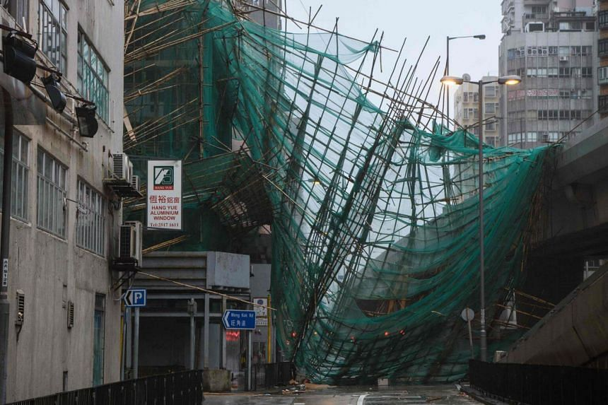 A collapsed bamboo scaffolding is seen hanging from a building during Super Typhoon Mangkhut in Hong Kong, on Sept 16, 2018.