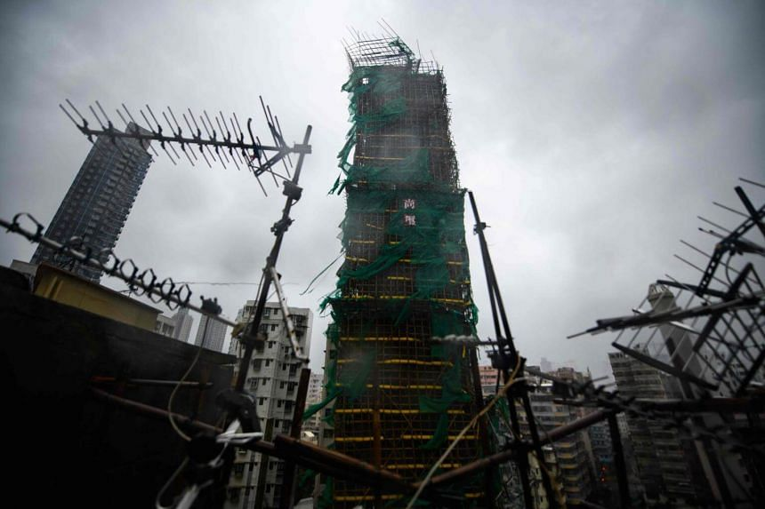 A building with damaged scaffolding is seen during Super Typhoon Mangkhut in Hong Kong, on Sept 16, 2018.