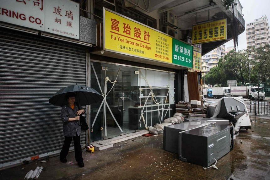 A woman prepares to walk in a street with her umbrella during Super Typhoon Mangkhut in Hong Kong, on Sept 16, 2018.