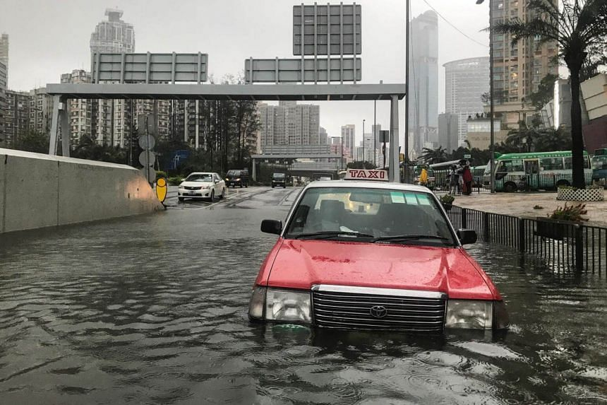 A taxi is abandoned in floodwaters during Super Typhoon Mangkhut in Hong Kong, on Sept 16, 2018.