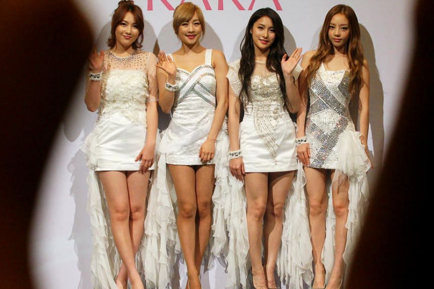 Singer Goo Ha-ra (far right) shot to stardom as a member of the K-pop group Kara. Some of the Kara members are pictured here at the Resorts World Convention Centre on July 10, 2012.