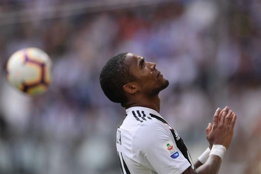 Juventus' Brazilian forward Douglas Costa reacts during the Italian Serie A football match between Juventus and Sassuolo on Sept 16, 2018 at the Juventus stadium in Turin.
