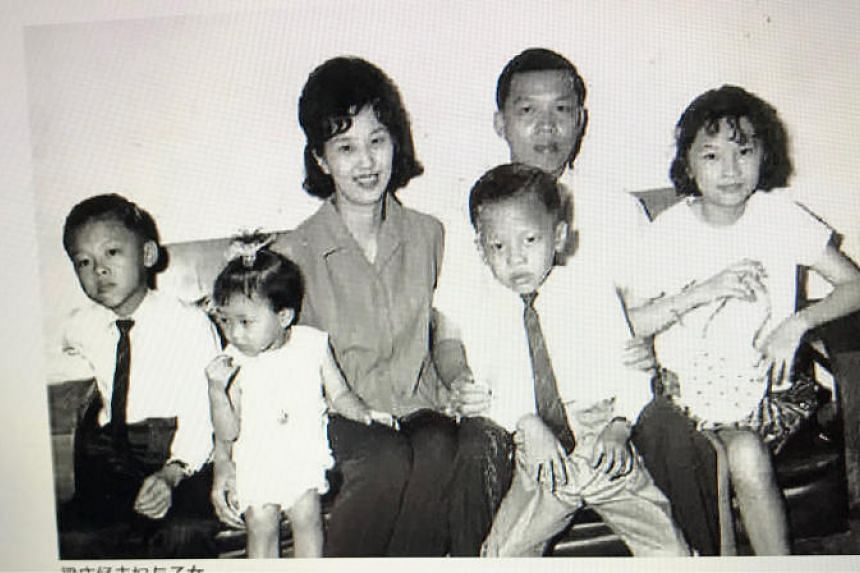 Dr Leong Heng Keng (second from right) with his family: (from left) son William, daughter Dorothy, wife Lo Tia Yia, son Chris (sitting on Dr Leong's lap) and daughter Katherine.