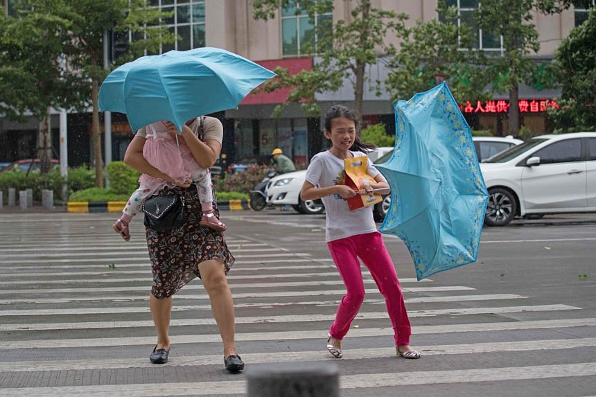 People battling strong winds ahead of Typhoon Mangkhut's arrival in Yangjiang, in China's Guangdong province, yesterday.