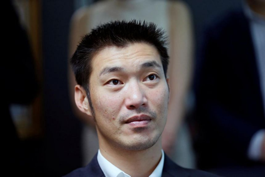 Thanathorn Juangroongruangkit, 39, founder of the Future Forward Party, was charged under the Computer Crimes Act after being questioned and fingerprinted at a Bangkok police station.