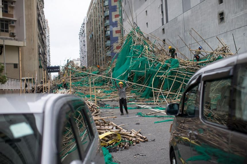 Labourers work on a bamboo scaffolding hit by Typhoon Mangkhut in Hung Hom district, Hong Kong, on Sept 17, 2018.