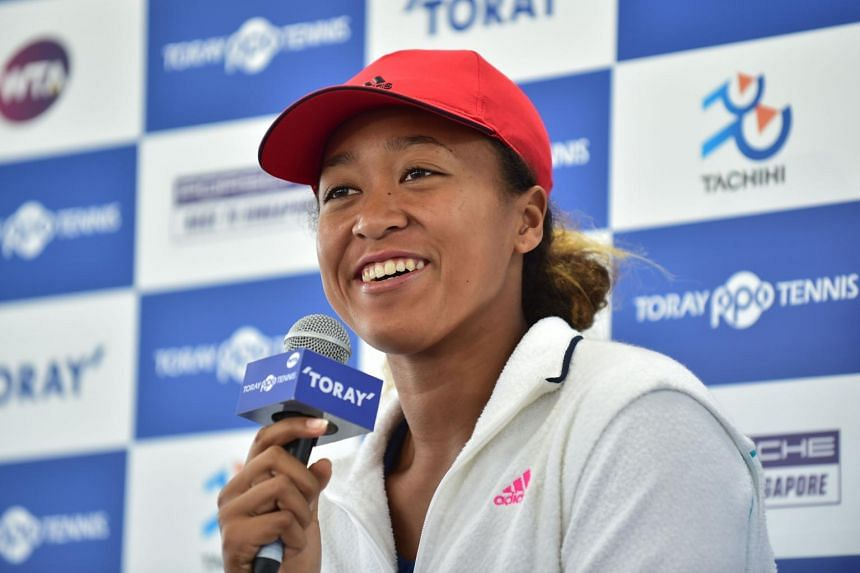 US Open champion Naomi Osaka answers questions during a press conference for the Pan Pacific Open tennis tournament in Tokyo, on Sept 17, 2018.