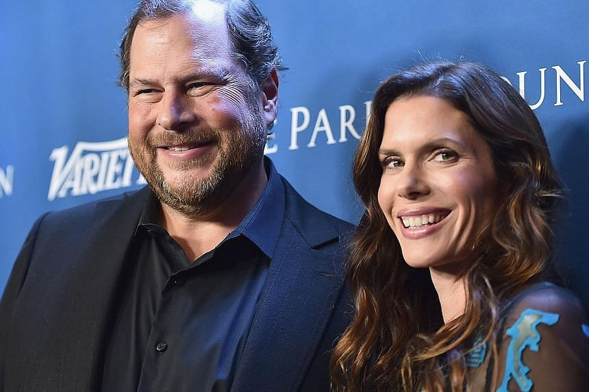 Mr Marc Benioff and his wife, Lynne, in a 2016 photo. The couple are paying $261 million in cash for the flagship publication of once-mighty Time Inc.