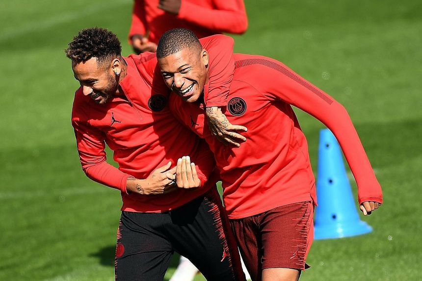Liverpool manager Jurgen Klopp has to prepare for his side's Champions League opener against French champions Paris Saint-Germain knowing their star forwards Neymar (far left) and Kylian Mbappe, seen during a training session in Paris, were wrapped i