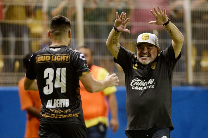 Argentine legend Diego Maradona (right) celebrates a goal with player Jose Alberto Garcia in Culiacan, Mexico, on Sept 17, 2018.