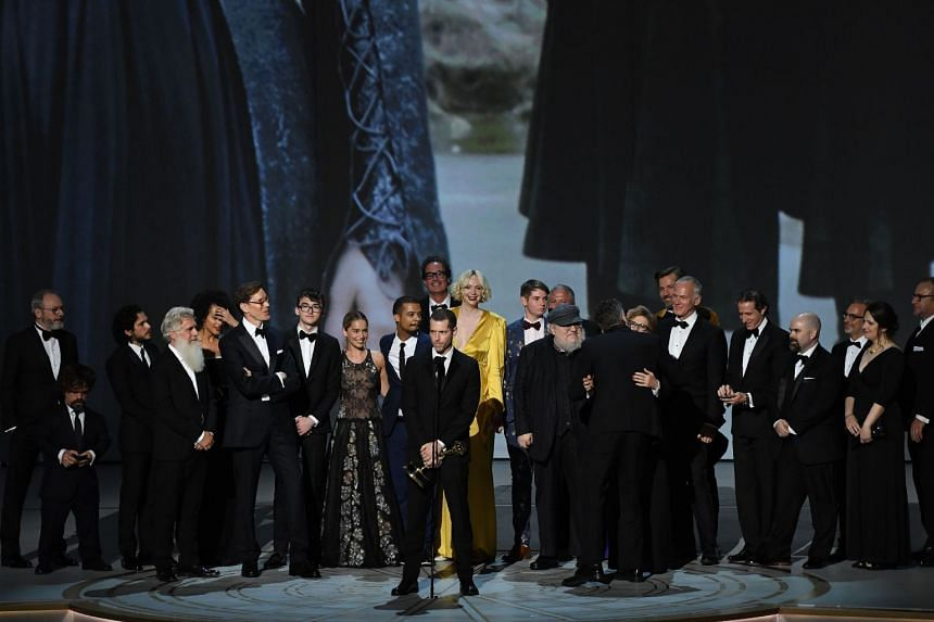 Writer-producer D.B. Weiss (centre left) and the cast of Game Of Thrones accept the award for Outstanding Drama series onstage during the 70th Emmy Awards at the Microsoft Theatre in Los Angeles, on Sept 17, 2018.