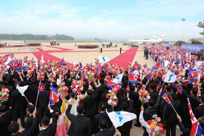 Officials attend an official welcome ceremony for South Korean President Moon Jae-in at the Sunan airport in Pyongyang on Sept 18, 2018.