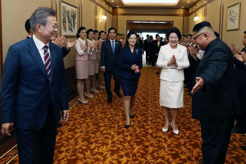 North Korean leader Kim Jong Un guides South Korean President Moon Jae-in and his wife Kim Jung-sook as they arrive at Baekhwawon State Guesthouse in Pyongyang on Sept 18, 2018.