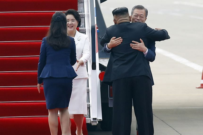South Korean President Moon Jae-in and his wife Kim Jung-sook are greeted by North Korean leader Kim Jong Un and his wife Ri Sol Ju as they arrive in Pyongyang on Sept 18, 2018.