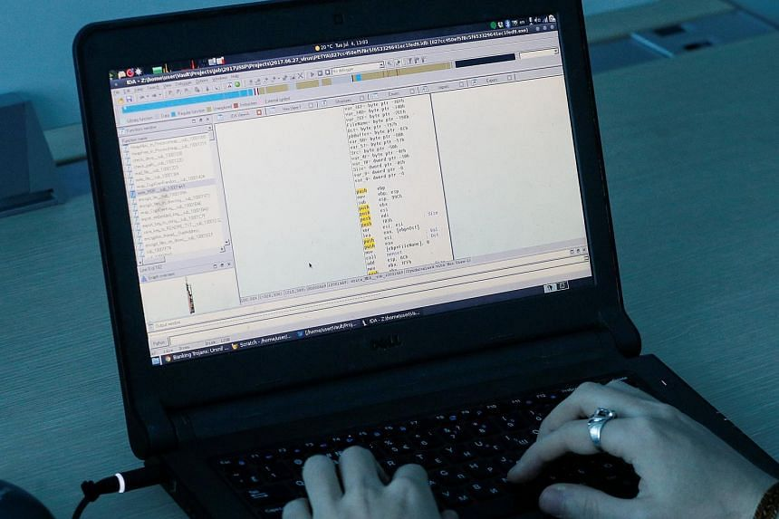 A man coding with a laptop. It is hoped the Cybersecurity Industry Call for Innovation will help participating organisations strengthen their cyber resilience while also providing opportunities for solution providers to develop and commercialise cutt