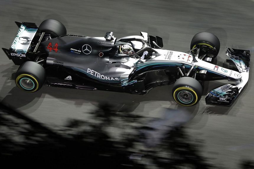 British Formula One driver Lewis Hamilton of Mercedes AMG Petronas F1 Team in action during the Formula One 2018 Singapore Airlines Singapore Grand Prix night race at the Marina Bay Street Circuit on Sept 16, 2018.