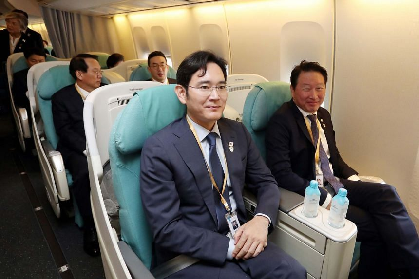 Samsung heir Lee Jae-yong (left, front), SK Chairman Chey Tae-won (right, front) and LG Chairman Koo Kwang-mo (right, back) a plane bound for Pyongyang at Seoul Air Base in Seongnam, on Sept 18, 2018.