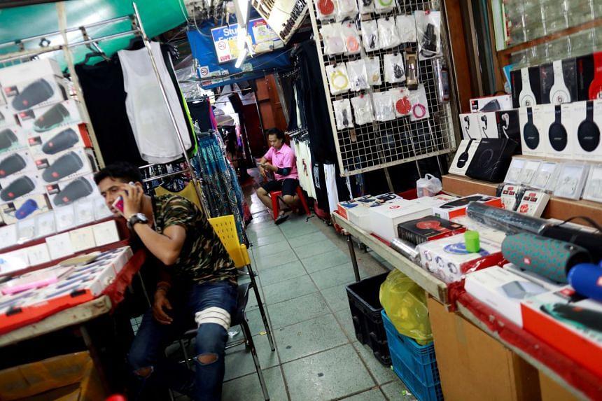 Street vendors selling phone accessories in Khaosan Road in Bangkok.