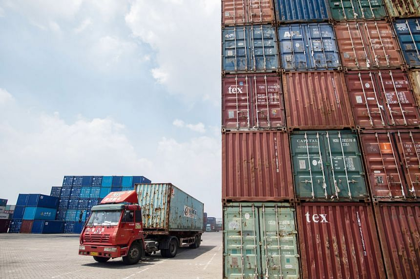 Stacked containers at a port in Zhangjiagang, China. Singapore's exports to China - its biggest single market - fell 17.8 per cent year on year last month.
