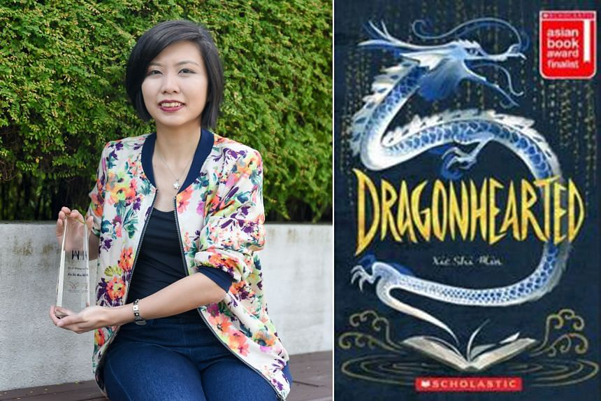 Dragonhearted (above), the debut novel of Xie Shi Min (left, with the Hedwig Anuar Children's Book Award), tells of a Singaporean-Chinese girl defeating a terrible, ancient monster.