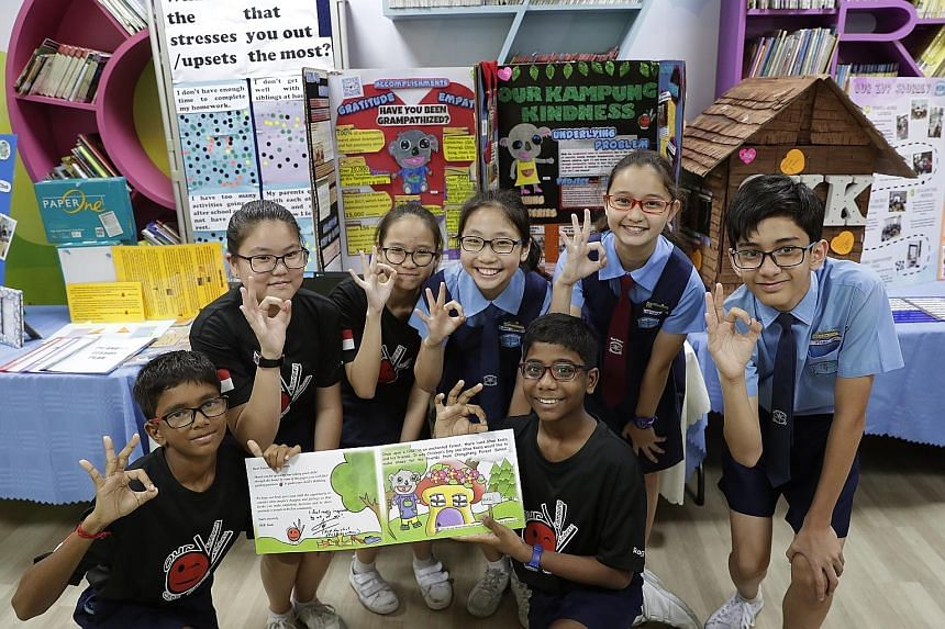 Pupils at Chongzheng Primary posing with an illustrated storybook that they put together under the school's Values in Action programme. The book aims to teach readers the importance of seeing things from others' perspectives, and of showing gratitude