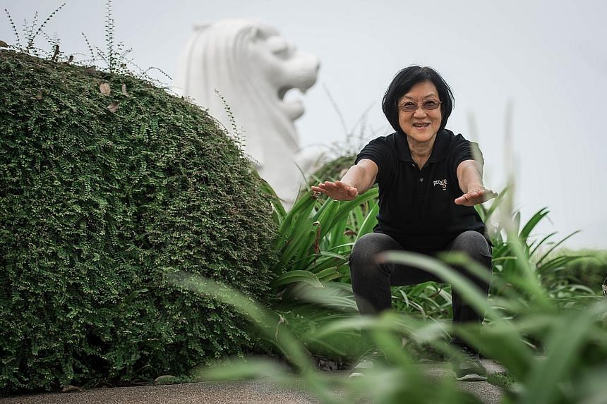 Mrs Lee Yen limbering up with squats and stretching exercises. The 67-year-old used to suffer from pain in her soles and kneecaps after brisk walking, but that eased after she took part in an exercise programme to help seniors build stronger muscles.