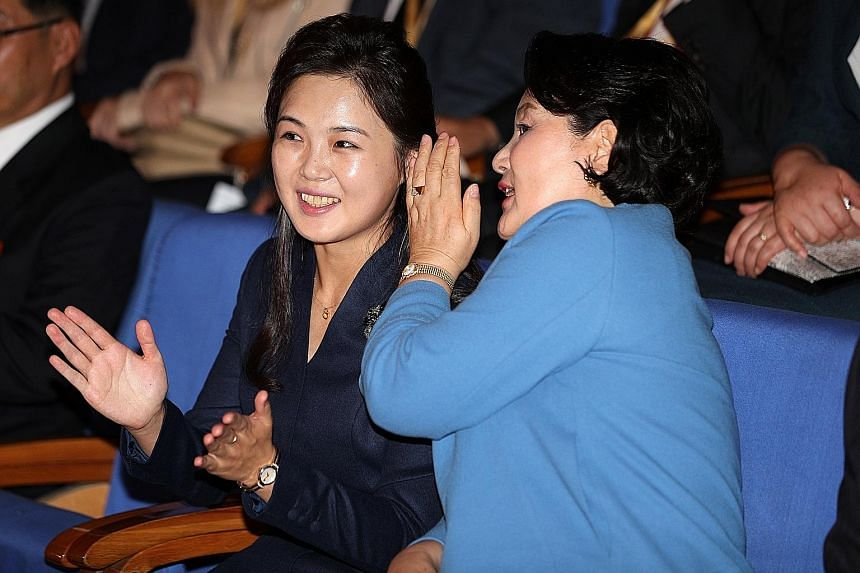 Ms Kim Jung-sook (right), wife of South Korean President Moon Jae-in, with Ms Ri Sol Ju, wife of North Korean leader Kim Jong Un, during a visit to a music school in Pyongyang yesterday.